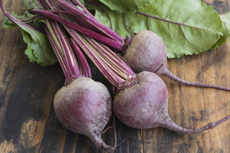 Fresh Young Beetroot on a Rustic Wooden Background. Stock Photo