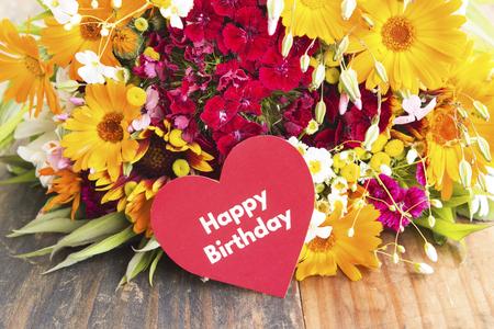 Happy Birthday Card with Spring Flowers . Standard-Bild - 101882572