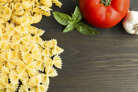 Italian cuisine with copy space for text on a wooden background. Standard-Bild - 102685982