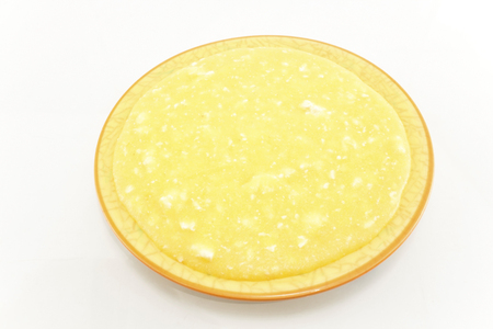 Polenta with Cheese in a Plate Isolated on White. Standard-Bild - 106147763