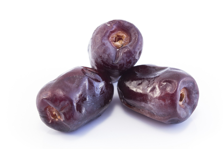 Three Ripe Dates Fruit Isolated on White. Standard-Bild - 106147764