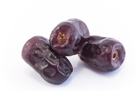 Three Ripe Dates Fruit Isolated on White. Standard-Bild - 106147765