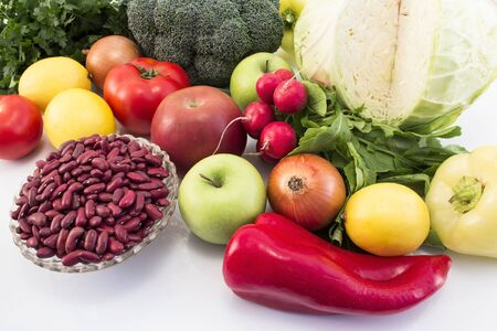 Healthy Fruits and Vegetables on White Background. Standard-Bild