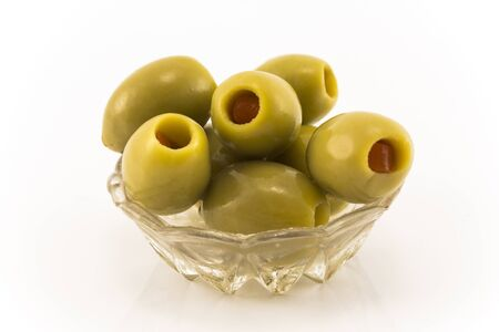 Green Olives Stuffed with Peppers, Isolated on White.