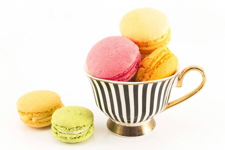 Colorful Macaroons in a Cup Isolated on White Background. Standard-Bild