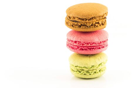 Three Fresh Colorful Macaroons Isolated on White Background.