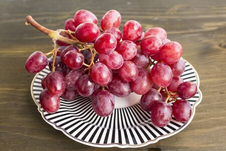 Red Sultana Seedless Grapes on a Plate.