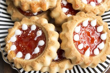 Tea Biscuits with Jam on a Plate.