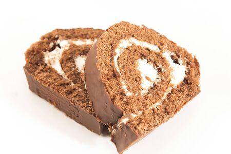 Sponge Cake Chocolate Roll Isolated on White.