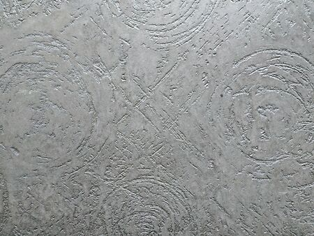 Texture decorative plaster. Abstract background gray texture with circular furrows Фото со стока