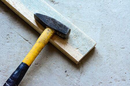 A slice lies on a boardwalk. Concrete floor hammer. 写真素材