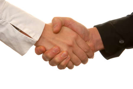 Man and woman are shaking hands on a white background. Stock Photo - 945708