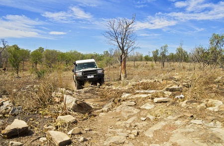 Driving on the the rough Australian outback road. Wild Road Trip Adventure in Northern Territory. Australia. Stock Photo - 9506234