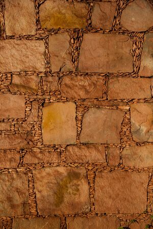 Texture made by a traiditional way of making walls with stone in brasil  photo