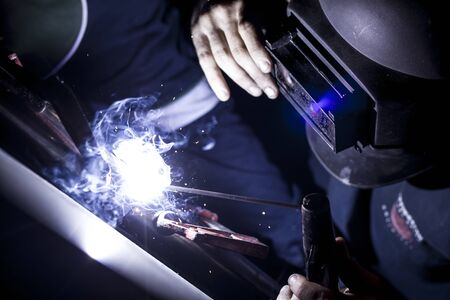 Man Welding with sparks  photo