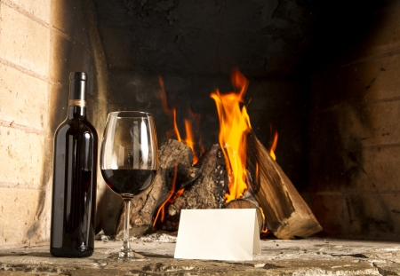Wine by the fireplace, glasses of wine  Message  Sample text Stock Photo - 19410161