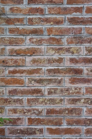 vignetted: red brick wall texture grunge background with vignetted corners of interior Stock Photo