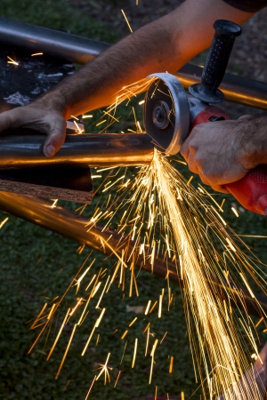 Man workin with iron, sparks  photo