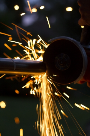 Man workin with iron, sparks  Stock Photo - 20022066