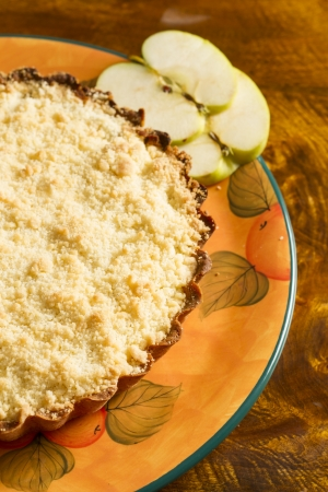 cheff: Apple cake with two slices of apple on an old wooden table
