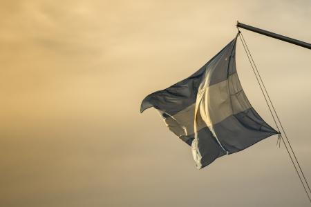 naturaleza: Waving Fabric Flag of Argentina Stock Photo