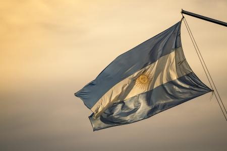san isidro: Waving Fabric Flag of Argentina Stock Photo