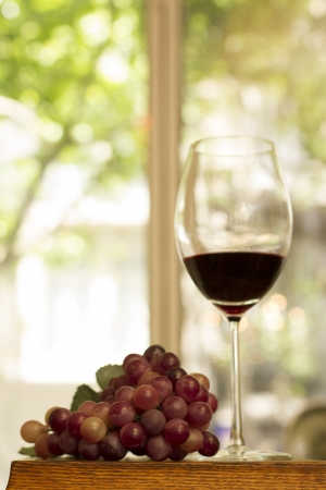 Wine glass, grape with natural bacgrpund photo