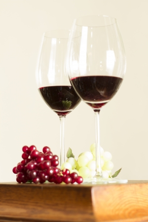 Glasses of wine and grape over white  photo
