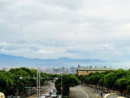 You can see an everyday view from a pedestrian bridge. The view is over the city of Taichung and at the background  Stok Fotoğraf
