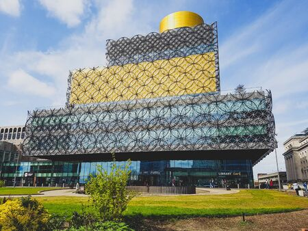 Walking through the city of Birmingham and saw this library. Its gold and has a nice metall architecture. Stok Fotoğraf
