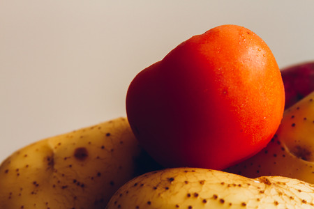 sidelight: Tomatoes and potatoes with white background