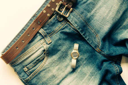 informal clothes: Jean with wristwatch with white background