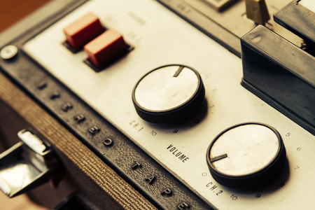 sonorous: Old tape recorder over wooden floor, with knobs and buttons