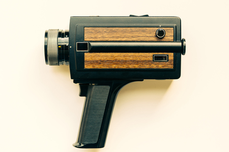 super 8: Old super 8 film camera over white background