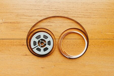 super 8: Super 8 film reel uncoiled on wooden boards