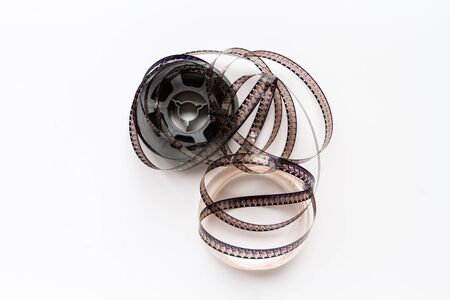 super 8: Uncoiled super 8 film reel over white background
