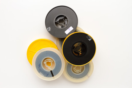 super 8: Many super 8 film reels over white background Stock Photo