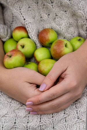 Woman holds apples
