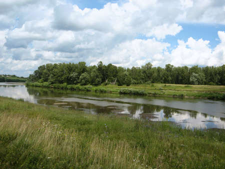 The view from the river plains and clouds Stock Photo