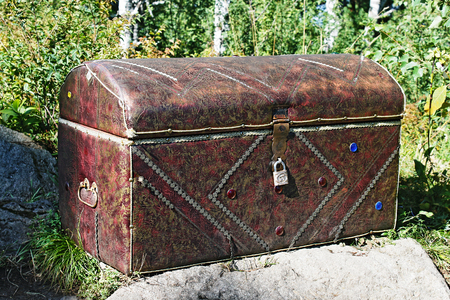 Old locked chest on a stone
