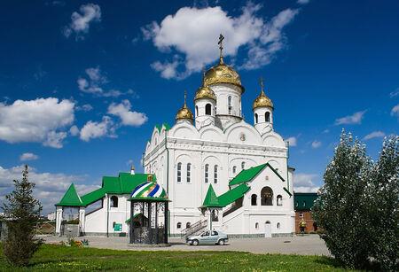 White-stone John the Theologian church in Barnaul sunny day