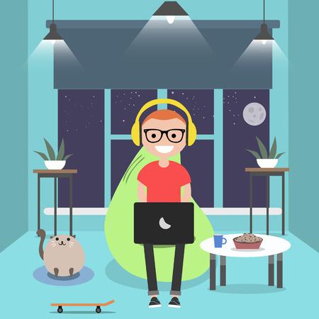 Young character sitting on bean bag with laptop.Night room.Gamer.Flat cartoon design Ilustração Vetorial