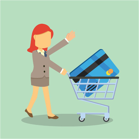 businesswoman with credit card and trolley