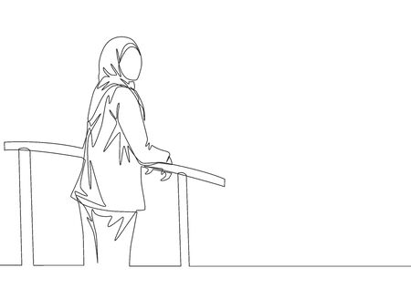 One single line drawing of young happy muslimah wearing head scarf and standing at fence. Beautiful Asian woman model in trendy hijab fashion concept continuous line draw design vector illustration