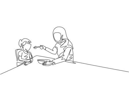 Single continuous line drawing of young Islamic mom feeding healthy food to daughter at breakfast time. Arabian muslim happy family motherhood concept. Trendy one line draw design vector illustration