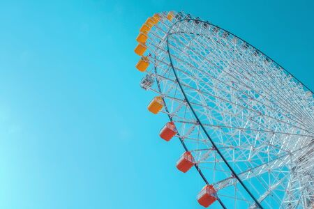 Stock Photo - Ferris wheel and blue sky