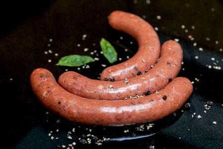 A Photograph of Fresh Raw Beef Sausage