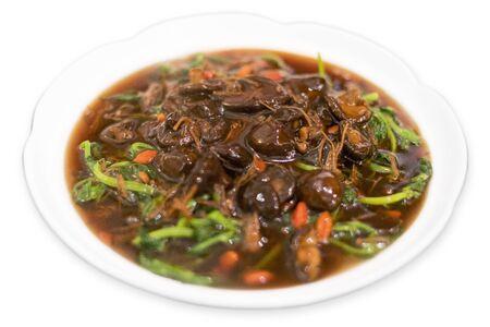Chinese fresh mushroom fried pea shoot dish in white background