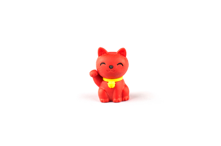 small red japanese cat doll on white background