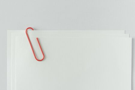 tack: white note paper with red paper clip on white background
